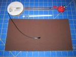 Project Supplies - Ribbon, ruler, white pencil, pins and pin cushion, and fabric